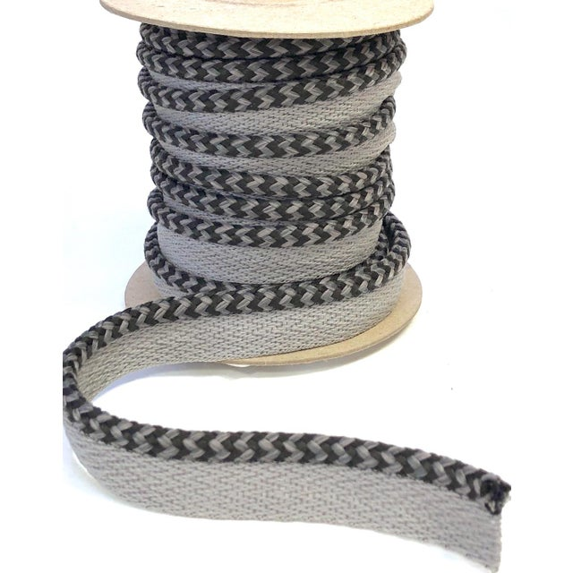"One 9 yard spool of 1/4"" braided cord with flange. Cord colors are mid-tone mingle gray and black. Flange is light gray..."