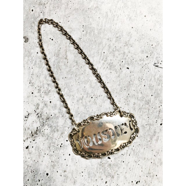A beautiful vintage circa 1910-20s sterling silver decanter or bottle tag. In excellent condition, no damage, light...