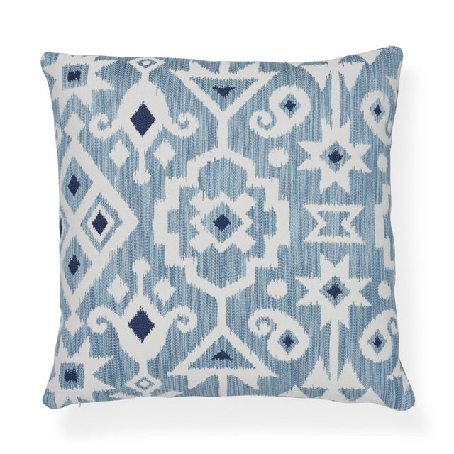 """This 20"""" x 20"""" pillow features Crusoe Ikat in Sky. Space-dyed yarns give this ikat a beautiful melange effect. With..."""