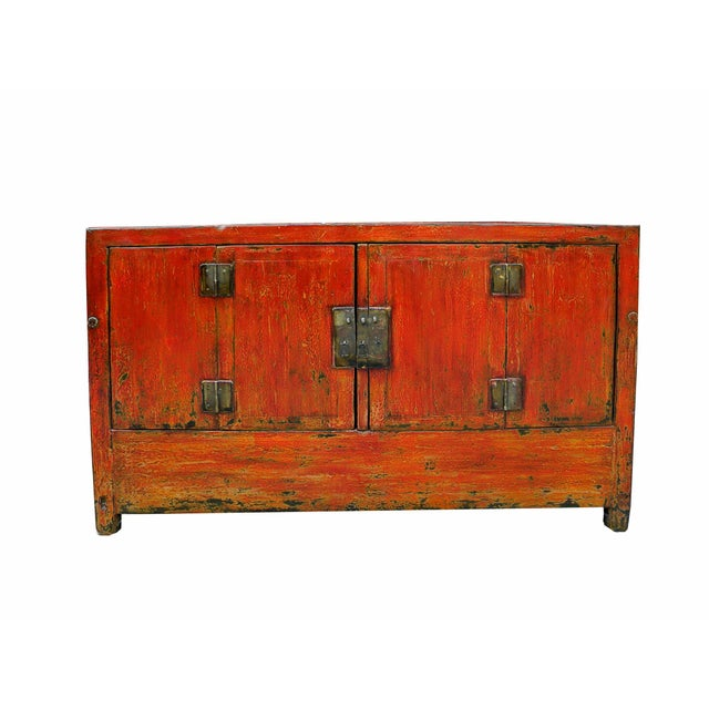 Original wood and brassware, this early 20th cabinet is brought up to modern life with a new finished antique red. With...