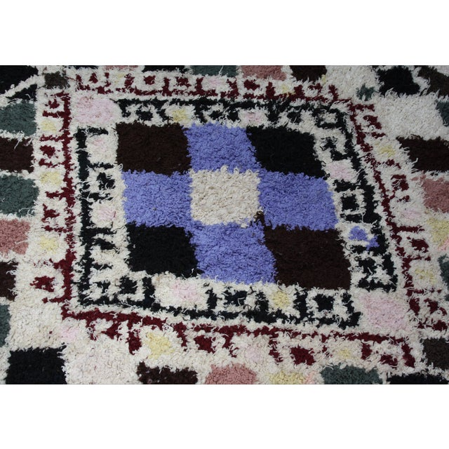 One-of-a-kind Moroccan rug that is composed of soft wool, hand-knotted in the High Atlas Mountains of Morocco. The design...