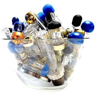 Collection of Vintage Motion Picture Projection Bulbs in New Italian Glass Vase For Sale