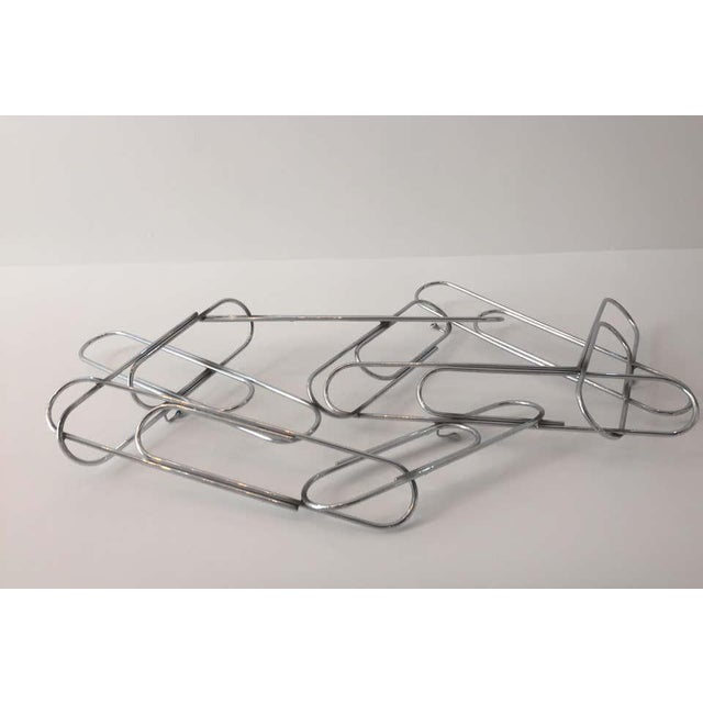This stylish large scale version of a cluster of paper clips was created in the 1970s by the iconic design team of Curtis...