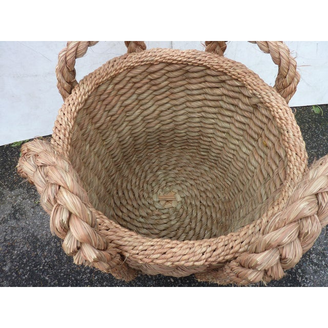 """Large woven grass basket with braided handles, inner dimensions are 21"""" Diameter by 21""""H."""