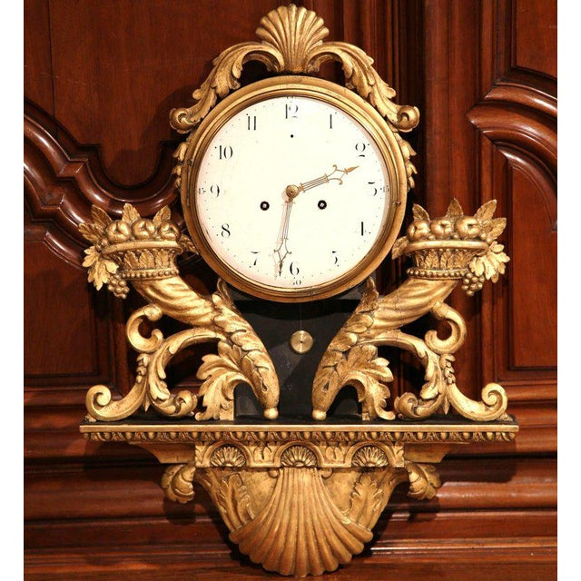 This elegant, antique wall clock was crafted in Lyon, France circa 1760. The traditional wall clock is in good working...