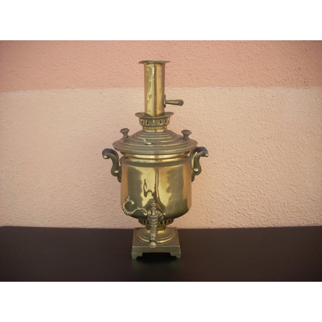 Solid brass with Cyrillic inscriptions on both the base and the lid; pre- revolution (1917); imperfections on chimney;...