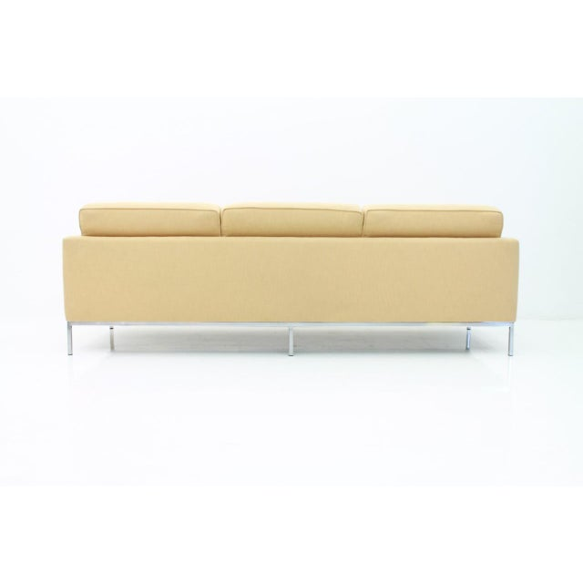 Three-seat sofa by Florence Knoll and made by Knoll International. The sofa was newly upholstery, circa three years ago....