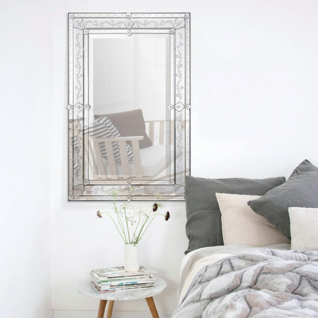 This elegant Venetian mirror features a classic etched pattern frame. Mirror is beveled.