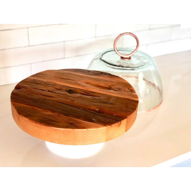 Reclaimed European hardwood paired with modern block wood base combines to make a striking piece that can transition...