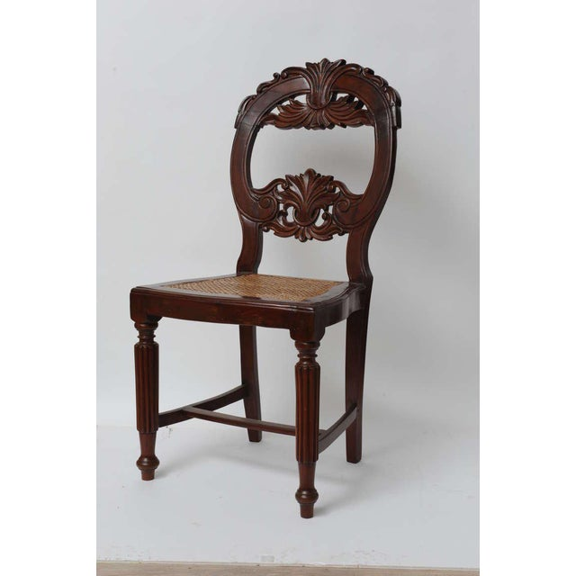 Set of four rare rosewood dining chairs from Portuguese Goa, late 1800s. Caned seats have been redone. Beautifully carved...