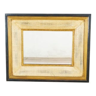 Black and Gold Frame Antiqued Mirror For Sale