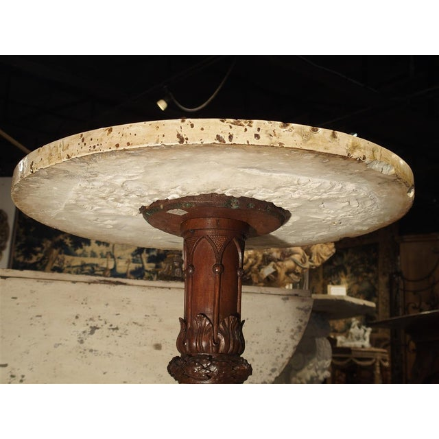 From Genoa Italy, this round walnut wood, bistro table with a marble top has the most spectacular hand carved pedestal....