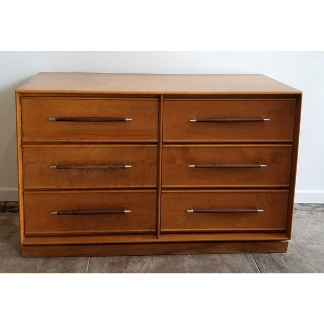 A beautiful vintage six-drawer Mid-Century Modern dresser by Heywood Wakefield. The dresser features clean, sleek Mid-...
