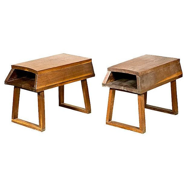 Offered is a pair of mid century modern end tables. The wooden tables feature an open storage compartment at the top....