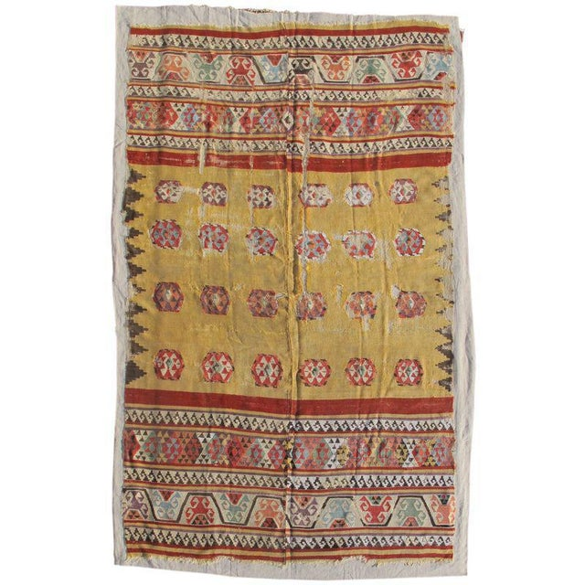 This exceptional early Anatolian kilim draws three distinct sections. Colorful energetic bands of ornament, using both...
