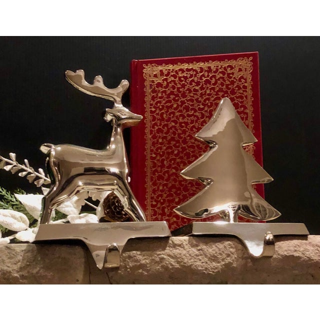 This is for a set of two silver Christmas stocking hooks for your mantle. They are originally from Pottery Barn. They are...