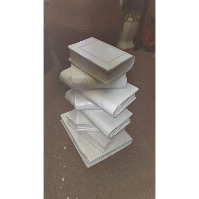 Chic hand carved stacked books end table. Great for a drinks or occasional table. Recently painted in satin white....