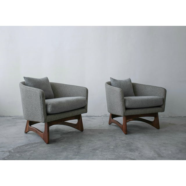 Rare pair of midcentury lounge chairs by Adrian Pearsall. These chairs have beautiful barrel shape and sculpted walnut...