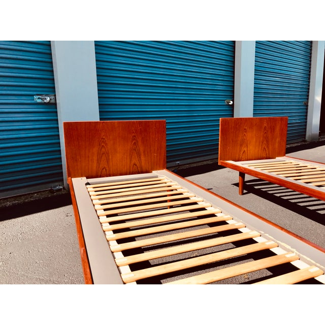 "A pair of Danish, twin (European size)platform beds by Hans Wegner. Each are approximately 33.5"" wide x 81.5"" long x 12""..."