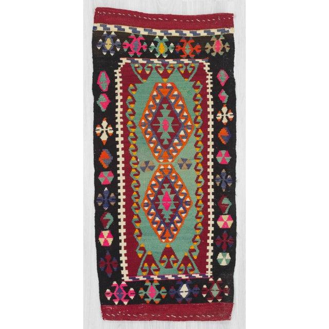 Handwoven vintage mini kilim rug from Malatya region of Turkey. In very good condition
