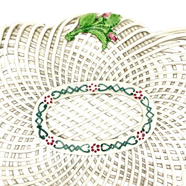 A fine 19th c. woven ceramic basket from England, c. 1850. The white basket has green leafage and pink flowers. Condition...