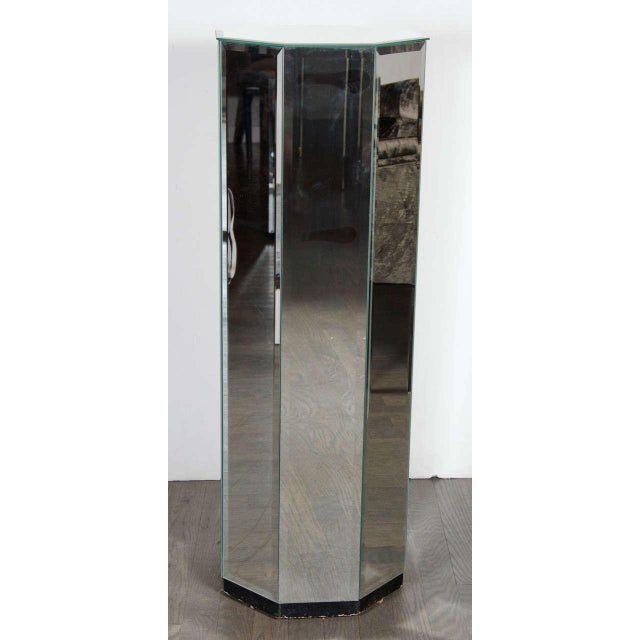 1970s mirrored pedestal in an octagon shape. This chic mirrored pedestal consists of beveled mirror on all eight sides...