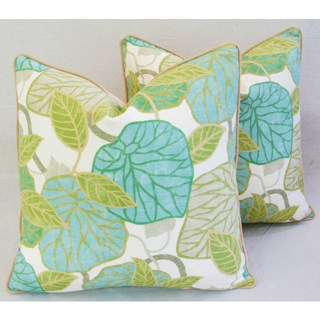 A pair of large custom-made pillows in a vintage cotton and linen blended fabric depicting a lush and colorful...