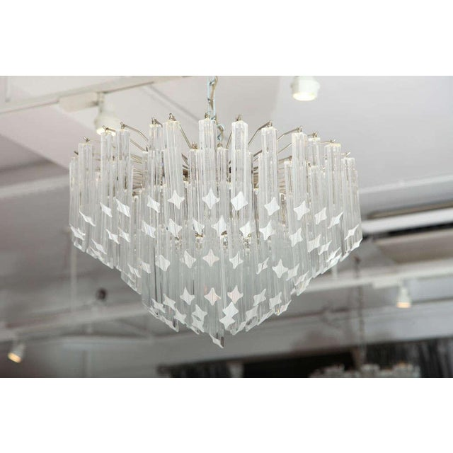 A stunning Venini glass chandelier made up of seven tiers of clear glass crystals.