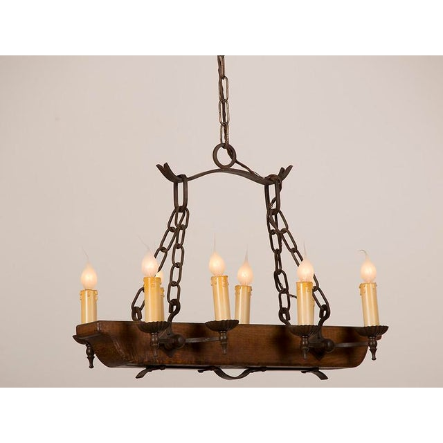 Fine vintage french eight light wooden beam iron chandelier circa vintage french eight light wooden beam iron chandelier circa 1940 image 2 of aloadofball Gallery