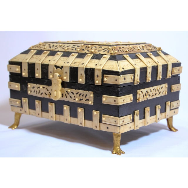 Nice and unusual decorative box adorned with hand carved horn. Anglo-Indian footed domed box with exceptional engraved...