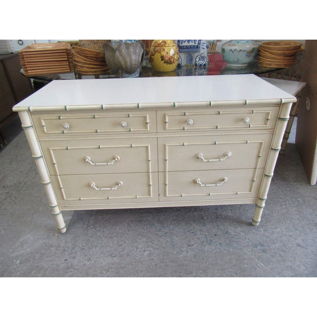 "Faux bamboo double dresser. It measures 30"" H x 46"" W x 19"" D. It is in good as found vintage condition."