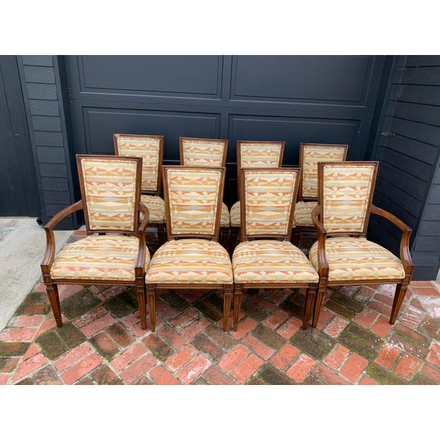 These vintage reproduction Louis XVI style dining chairs are made of walnut and upholstered. Traditional yet timeless in...