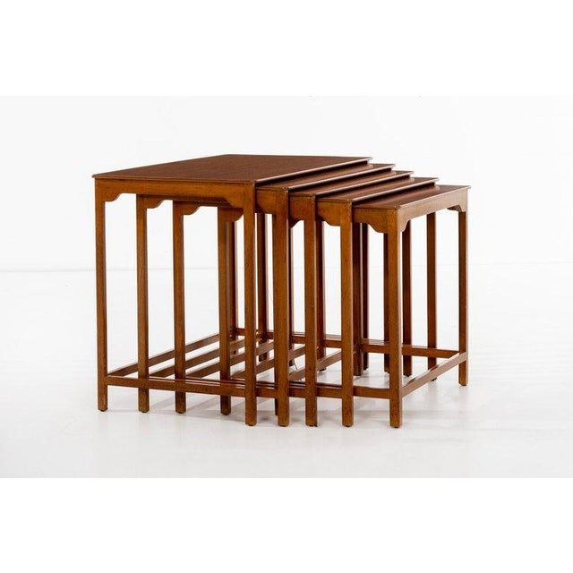 Edward Wormley (1907 - 1995) Model no. 4785 Set of five mahogany and walnut nesting tables with scalloped aprons and...