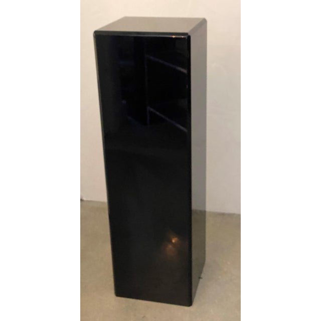 This pieces dates to the 1990s and is fabricated in black Lucite.