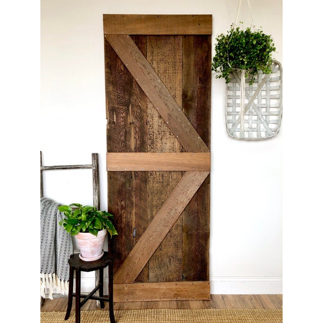 This wooden plank door with its rustic patina will enhance your farmhouse style interior or front porch. You are bringing...
