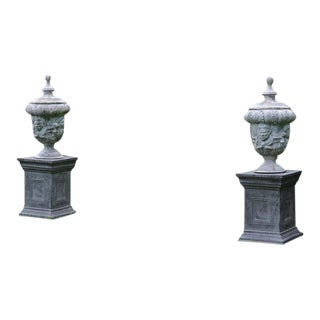 Pair of Classical Lead Urns on Pedestals For Sale