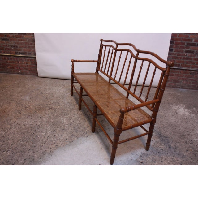 Exquisite hall-seat, (circa 1950s) with shapely back, faux-bamboo frame legs (with similar stretchers), and cane seat....