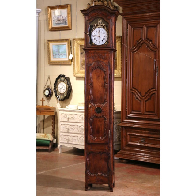 This elegant, antique long case clock was crafted in Lyon, France, circa 1760. The tall fruitwood grandfather clock, built...