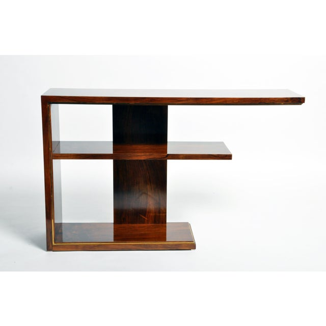 This gorgeous Art Deco console table is from Hungary and made from walnut veneer, circa 1940. The piece features shelves...