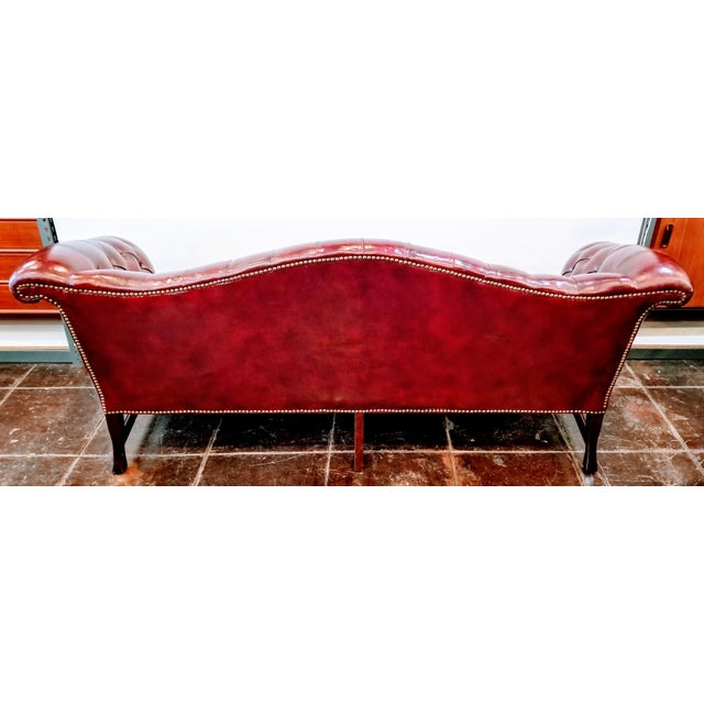 Vintage Burgundy Leather Button Tufted Camel Back Sofa With Antiqued Brass Nailheads For Sale - Image 4 of 10