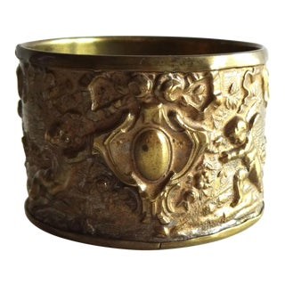 Late 19th Century Antique French Rococo Repoussé Brass Napkin Ring With Cherubs For Sale