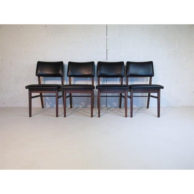 Jens Risom / B.L. Marble co. Series 7611 solid walnut & black naugahyde dining chairs. Circa 1961. In amazing original...