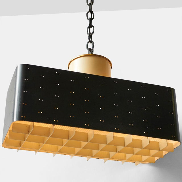 """A rectangular """"starry sky"""" pendant or ceiling lamp #9068 by Paavo Tynell for Idman. Lacquered black brass perforated frame..."""