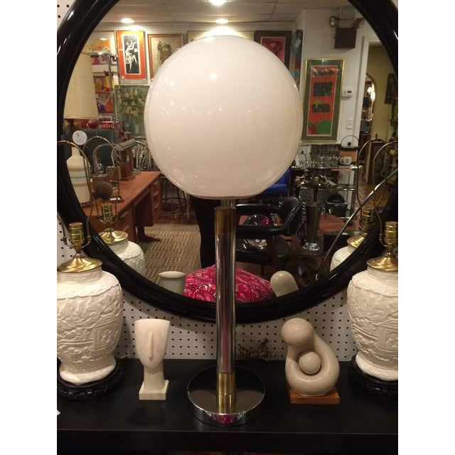 Robert Sonneman Style lollipop table lamp. Classic lines make up this chrome beauty with banded brass accents. Round...