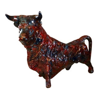 Haeger Style Mid Century Ceramic Bull Figurine With Red Marble Glaze For Sale