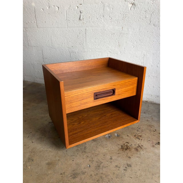 Timeless, expertly crafted midcentury Danish modern teak nightstand C1970s. This functional nightstand or end table is an...