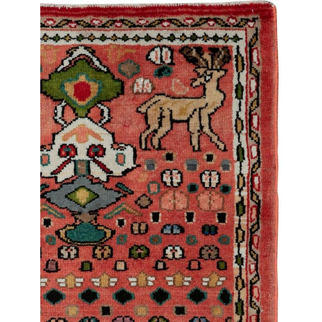 A vintage Persian Mahal rug from the mid-20th century. The Sultanabad/Arak rug weaving area produces several grades of...