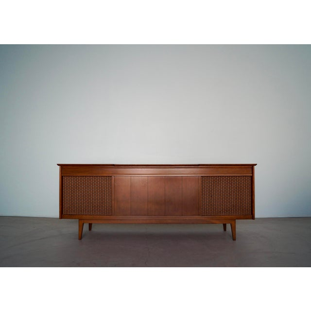 We have this beautiful original 1960's Mid-Century Modern record console / media credenza for $2,250. It was manufactured...