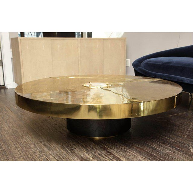 Spectacular round etched brass and agate cocktail table.
