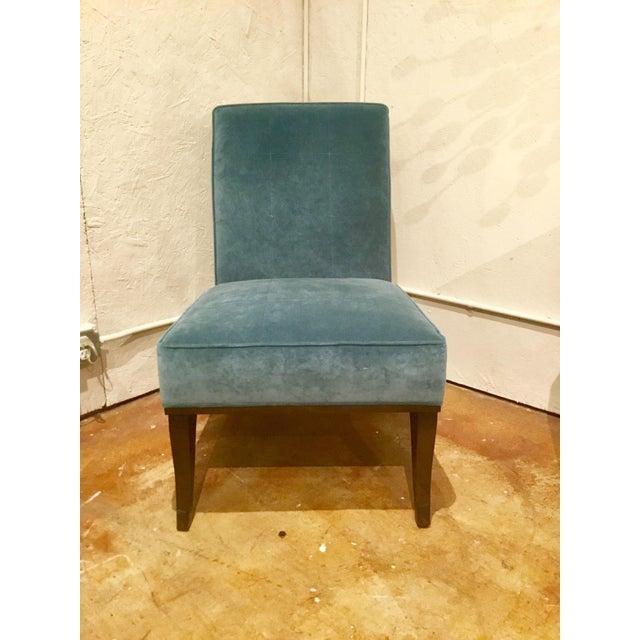Pair of opulent blue velvet Gigi Slipper Chairs by: Ambella Home, mahogany finished frame, showroom floor sample, original...
